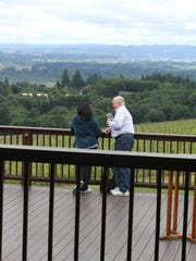 Guests enjoy the views from the deck at Domaine Drouhin on Saturday, May 23, 2015.
