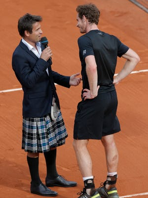 Former tennis player Fabrice Santoro of France sports a kilt as he interviews Britain's Andy Murray at the French Open in Paris, on  May 28, 2015.