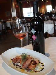 Filetto di conigilo is a rabbit loin with son daniele prosciutto, endive, treviso and sabo drizzle at Zuppa restaurant in Yonkers.