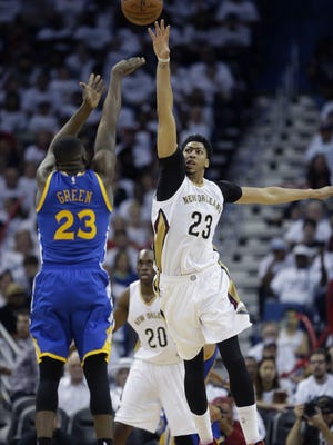 Golden State Warriors forward Draymond Green (23) shoots against New Orleans Pelicans forward Anthony Davis (23) during the second half of Game 4 of a first-round NBA basketball playoff series in New Orleans, Saturday, April 25, 2015. The Warriors won 109-98 to sweep the series.  (AP Photo/Gerald Herbert)