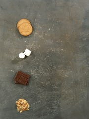Ingredients for s'mores with toasted almongs.