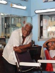 """Barber"" taken by Victoria Blewer on a recent trip to Cuba, on display at Frog Hollow in Burlington."