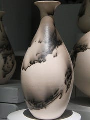 This raku vase by Kim Peterson is featured at the 66th annual Salem Art Fair & Festival.