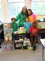 Students in Oak Knoll School of the Holy Child's first-grade classes ran a donation drive in June to support St. Hubert's Animal Welfare Center, which has locations in Madison and Branchburg. Pictured, from left, are: Chloe Korn, Class of 2026, of Summit; Rye Fleming, Class of 2026, of Summit; Ann Higgins, first-grade math teacher; Jeanne Mackin, first-grade language arts and reading teacher; Lydia Castelblanco, Class of 2026, of Summit; and Nicholas Anderson, Class of 2026, of South Orange.