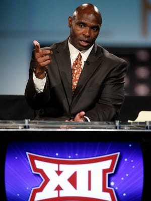 Texas head football coach Charlie Strong responds to questions in a broadcast interview during the Big 12 Conference Football Media Days Tuesday, July 21, 2015, in Dallas. (AP Photo/Tony Gutierrez)