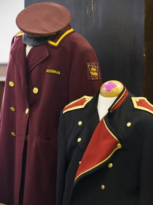 Old doorman and bellhop uniforms sit at Hotel Fort Des Moines on Wednesday, July 22, 2015. A massive sale of Hotel Fort Des Moines memorabilia will be held Aug. 7-9.