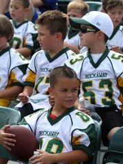 Dominic Graziano, 8, of the Rockaway Township Rockets, a Morris County Youth Football League team, attends Youth Football Day at the NY Jets 2015 Training Camp at the Atlantic Health Jets Training Center in Florham Park, NJ Monday August 24, 2015.