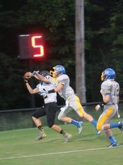 Wayne County's Dillon Horton catches one of his two touchdowns against Clarksville Academy Friday night at Simpson Field.