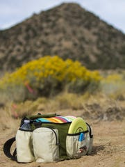 A bag of discs used by Mason Christison at Three Peaks Disc Golf Course, Saturday, Sept. 26, 2015.