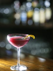 "The ""Concord grape martini"" at Avvino in Brighton prepared by owner Janine Wasley."