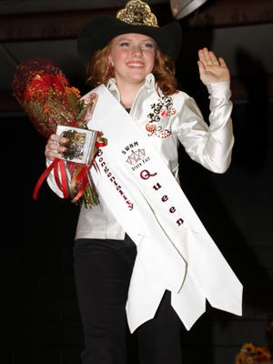 Kaitlyn Reed, 15, waves to the audience Thursday after being crowned 2015 Southwestern New Mexico State Fair Queen at the fairgrounds in Deming.