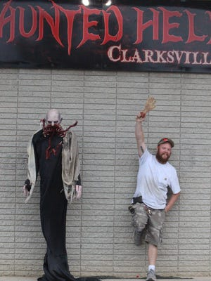 Patrick Warner waves with a fake severed hand outside Haunted Hell Clarksville.