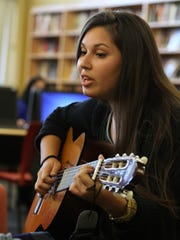 Monica Flores, 17, sings an original song, Blank Pages,