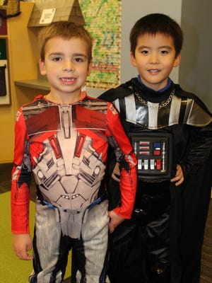Reid Kamphius and Reo Huh show off their Halloween costumes at Spooktacular 2014.