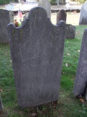 Graffiti scratched into a headstone at the Old Dutch