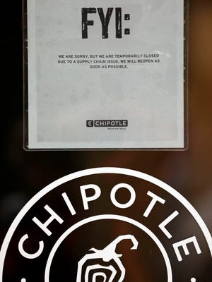 A sign on a Chipotle restaurant advises that it's closed because of a supply chain issue Monday, Nov. 2, 2015, in Seattle. An E. coli outbreak linked to Chipotle restaurants in Washington state and Oregon has sickened nearly two dozen people in the third outbreak of foodborne illness at the popular chain this year. Cases of the bacterial illness were traced to six of the fast-casual Mexican food restaurants, but the company voluntarily closed down 43 of its locations in the two states as a precaution. (AP Photo/Elaine Thompson)