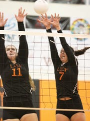 Captain Jessica Ricciardelli and Marco's Emmanuelle Meurgue rise in unison but barely miss blocking a shot in Lely's three-set loss to Tampa Robinson Tuesday night.