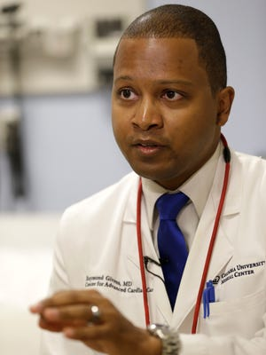 Dr. Raymond Givens speaks during an interview at Columbia University Medical Center in New York, Nov. 3. Givens was the leader of a new study that found that wealthy people are more likely to get themselves onto multiple transplant waiting lists and score a donated organ, and less likely to die while waiting for one to become available.