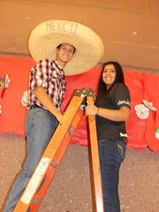 Mari Sandoval and Zack Hurt decorate the senior hall for Homecoming at Beaver Dam High School.