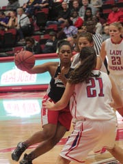 Rossview's Semajia Ogburn tries to drive past Montgomery