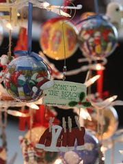 The Freehold Raceway Mall and its stores are decorated for the holiday season. Pictured are ornaments for sale at a mall kiosk, Jersey 4 Sure.