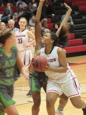 Rossview's Samaija Ogburn attempts a shot under the basket against Station Camp Tuesday night at Rossview High School.