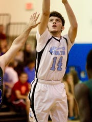 Brandon Estremera connected for 33 points in Marco Island Academy's exciting 58-55 win Wednesday night.