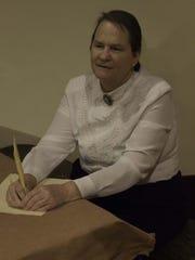 Pat Aynes of Garden City portrays Helen Keller, one