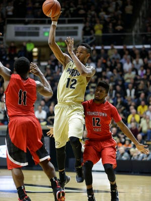 Purdue forward Vince Edwards (12) passes over Youngstown State guard Latin Davis (11) in the second half of an NCAA college basketball game in West Lafayette, Ind., Saturday, Dec. 12, 2015. Purdue defeated Youngstown State 95-64. (AP Photo/Michael Conroy)
