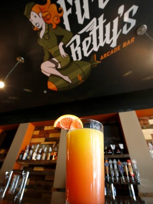 Fire Betty's namesake cocktail, with Bacardi 151, peach schnapps, Malibu rum, raspberry vodka, orange juice and grenadine.