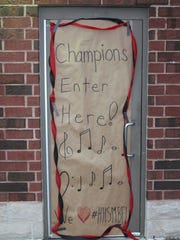 This sign was one of the first things members of the Harding High School Marching Band saw when they stepped off the bus Sunday evening at the high school.