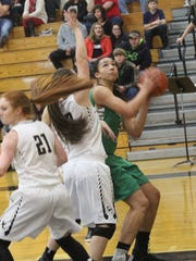 Houston County's Olivia White tries to put up a shot