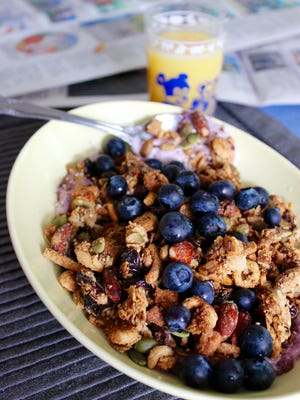Olive oil pairs well with almonds in this healthy granola, adding a bit of a smoky taste and enhancing the nutty flavor.