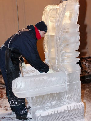 The ornate ice throne is a popular prop in IceFest photographs.