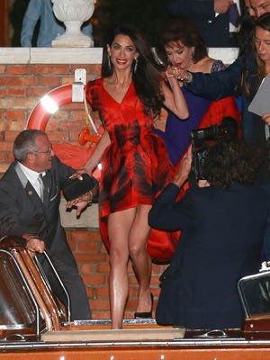Amal Alamuddin boarding water taxi with female wedding party for bachelorette party in Venice on Sept. 26.