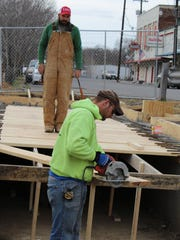 Workers of Leon Ross Construction working on the last of three phases of downtown Erin beautification.