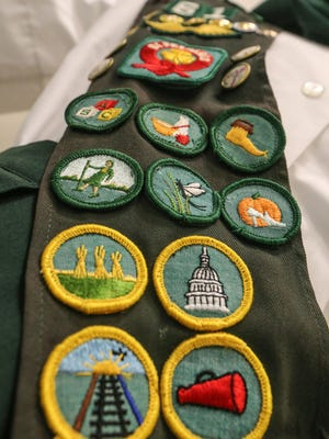 Badges fill the sash of a Girl Scout uniform on display in the new Northern Resource Center for the Girls Scouts of the Chesapeake Bay.