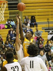 Northwest and Kenwood battle for a rebound during the