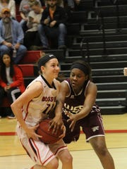 Rossview's Macy Rippy tries to gain control of the