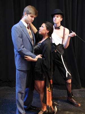 "Zach Warner as Cliff Bradshaw, from left, Rebecca LaPorte, as Sally Bowles, and Gabe Elmore, as The Emcee, star in Western Oregon University's production of ""Cabaret"" Feb. 25-28 and March 2-5 at Rice Auditorium."