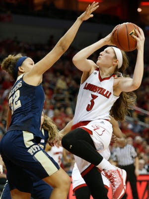 Louisville's Sam Fuehring drives to he basket against Pitt's Kalista Walters. Feb. 28, 2016