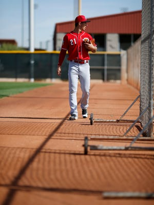 Cincinnati Reds pitcher Michael Lorenzen (21) walks on to the field before practice at the Cincinnati Reds Player Development Complex in Goodyear, Ariz., on Monday, Feb. 29, 2016.