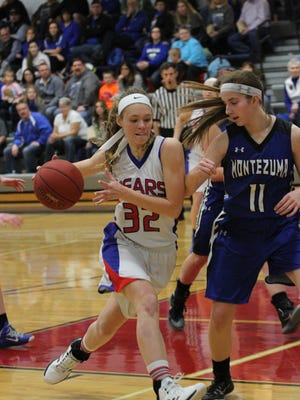 BGM's Jolissa Kriegel, 32, drives towards the basket during the season. Kriegel, who led the state in rebounds for all classes, was selected to the SICL All-Conference team this season.