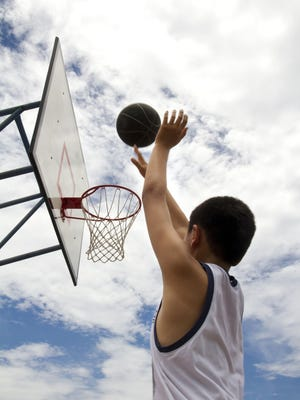 Practicing shooting in basketball