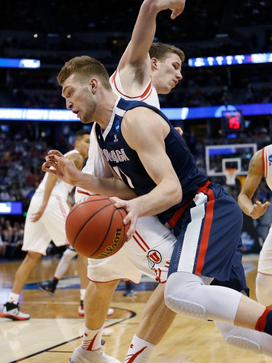 Gonzaga forward Domantas Sabonis, front, drives past Utah forward Jakob Poeltl during the first half of a second-round men's college basketball game Saturday, March 19, 2016, in the NCAA Tournament in Denver. (AP Photo/Brennan Linsley)