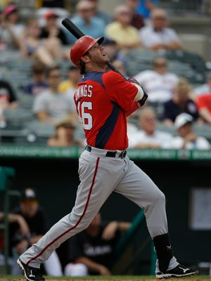 Micah Owings bats during the seventh inning of an exhibition spring training game with the Washington Nationals in 2013. Owings signed with the York Revolution for 2016.