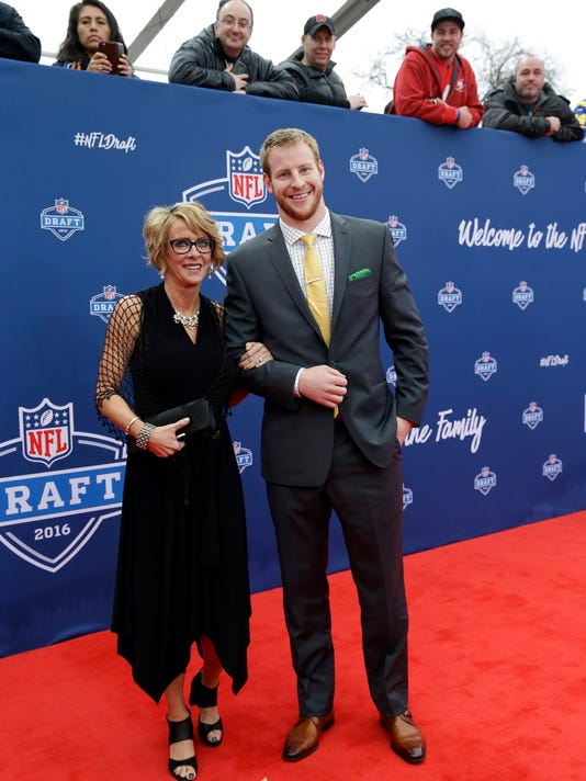 North Dakota State's Carson Wentz, right, poses for photos upon arriving for the first round of the 2016 NFL football draft at the Auditorium Theater of Roosevelt University, Thursday, April 28, 2016, in Chicago. (AP Photo/Nam Y. Huh)