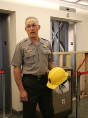 Chuck Burton, facility manager, introduces the elevators