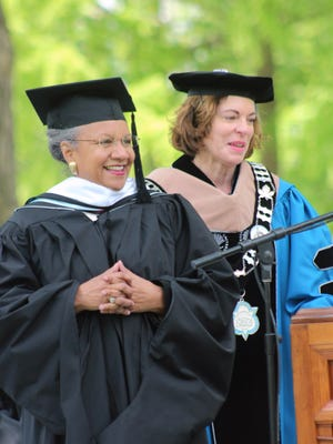 A'Lelia Bundles, left, an author and journalist who gave the commencement address to Wilson College's Class of 2016 on Sunday, receives an honorary degree from Wilson President Barbara K. Mistick.