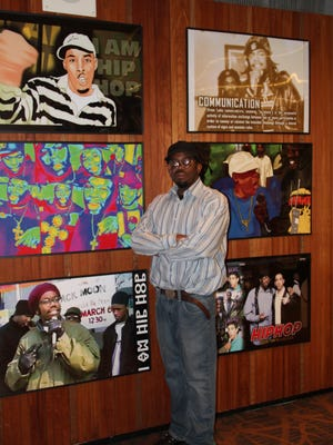 Plainfield-based hip hop videographer, author and magazine publisher Kurtiss Jackson, aka Kurt Nice, has donated his 25-year archive to the Plainfield Public Library Hip Hop Archive collection. He is pictured with six specialty posters from the upcoming exhibit that will open May 21, run through July, and then be available for research.
